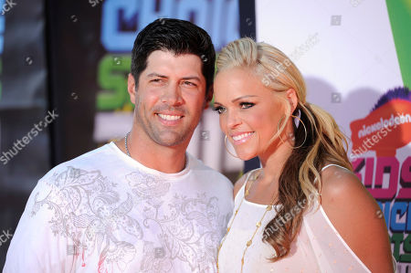 Stock Picture of Casey Daigle, left, and Softball player Jennie Finch arrives at the Kids' Choice Sports Awards at UCLA's Pauley Pavilion, in Los Angeles