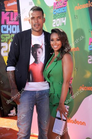 Matt Barnes, left, and Gloria Govan arrive at the Kids' Choice Sports Awards at UCLA's Pauley Pavilion, in Los Angeles