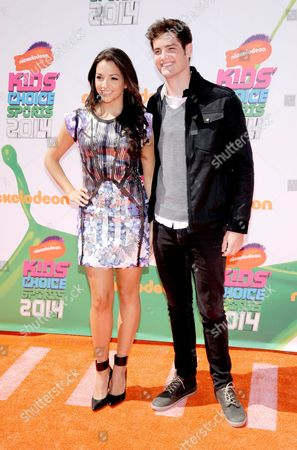 Ana Villafane, left, and Ben Winchell arrive at the Kids' Choice Sports Awards at UCLA's Pauley Pavilion, in Los Angeles