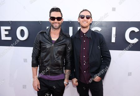 Adam Levine, left, and Jesse Carmichael arrives at the MTV Video Music Awards at The Forum, in Inglewood, Calif