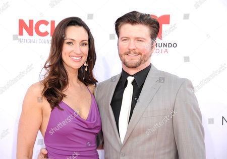 Stock Photo of Mia Mastroianni, left, and David J. Phillips arrive at the NCLR ALMA Awards at the Pasadena Civic Auditorium, in Pasadena, Calif