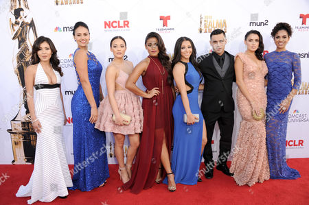 Ashley Campuzano, and from left, Alicia Sixtos, Alexandra Rodriguez-Segal, Vivian Lamolli, Danielle Vega, Gabriel Chavarria, Vannessa Vasquez, and Andrea Sixtos arrive at the NCLR ALMA Awards at the Pasadena Civic Auditorium, in Pasadena, Calif