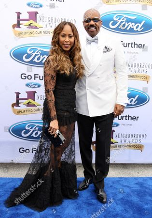 Comedian and talk show host Steve Harvey, with his wife, Marjorie Bridges-Woods, walked the Ford blue carpet at the 2014 Neighborhood Awards held at the Philips Arena, in Atlanta, Ga