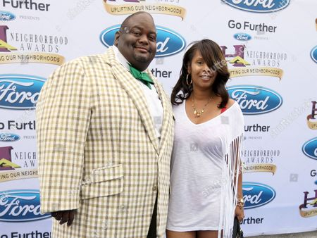 Comedian Lavell Crawford and his wife, DeShawn, walked the Ford blue carpet at the 2014 Neighborhood Awards held at the Philips Arena, in Atlanta, Ga