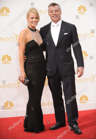 Andrea Anders, left, and Matt LeBlanc arrive at the 66th Annual Primetime Emmy Awards at the Nokia Theatre L.A. Live, in Los Angeles