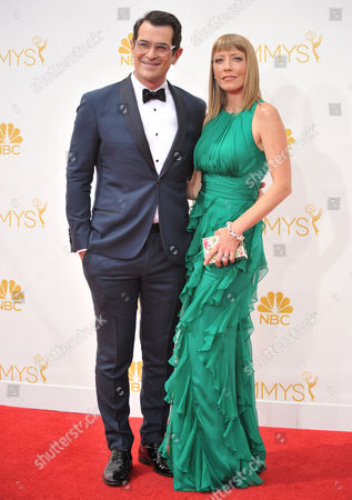 Ty Burrell, left, and Holly Anne Brown arrives at the 66th Annual Primetime Emmy Awards at the Nokia Theatre L.A. Live, in Los Angeles