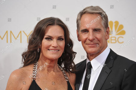 Scott Bakula, right, and Chelsea Field arrive at the 66th Annual Primetime Emmy Awards at the Nokia Theatre L.A. Live, in Los Angeles