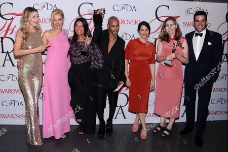 From left, Gigi Hadid, Nadja Swarovski, Rosie Assoulin, Shayne Oliver, Floriana Gavriel, Rachel Mansur, and Zacharay Quinto attend the 2015 CFDA Fashion Awards at Alice Tully Hall, in New York