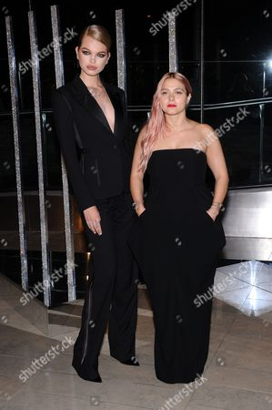 Stock Photo of Daphne Groeneveld, left, and Eva Zuckerman attend the 2015 CFDA Fashion Awards at Alice Tully Hall, in New York