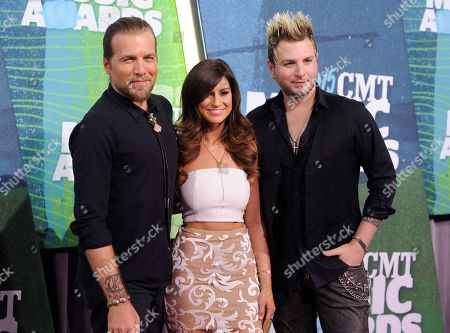 Stock Image of Tom Gossin, from left, Rachel Reinert, and Mike Gossin, of the musical group Gloriana, arrive at the CMT Music Awards at Bridgestone Arena, in Nashville, Tenn