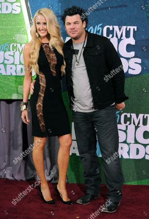 Jenna Michelle Straub, left, and Dee Jay Silver arrive at the CMT Music Awards at Bridgestone Arena, in Nashville, Tenn