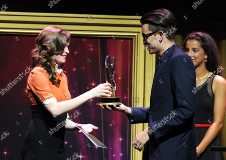 """Danielle Panabaker, left, presents the 1st place commercial award to Christopher Campbell, of Art Center College of Design, for """"Maglite â?"""" Dreamweaver"""" at the 36th College Television Awards, presented by the Television Academy Foundation at the Skirball Cultural Center in Los Angeles on"""