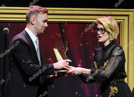 """Sarah Paulson, from right, presents Henry Hughes, of American Film Institute, the Directing Award for """"Day One"""" at the 36th College Television Awards, presented by the Television Academy Foundation at the Skirball Cultural Center in Los Angeles on"""