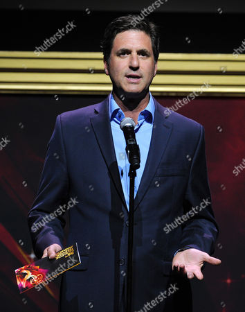 Steven Levitan presents an award at the 36th College Television Awards, presented by the Television Academy Foundation at the Skirball Cultural Center in Los Angeles on