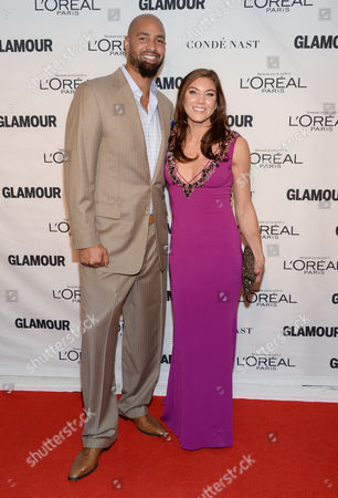 Jerramy Stevens, left, and Hope Solo attend the 25th annual Glamour Women of the Year Awards at Carnegie Hall, in New York