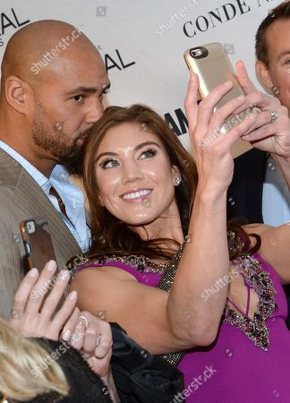 Jerramy Stevens, left, and Hope Solo take a selfie at the 25th annual Glamour Women of the Year Awards at Carnegie Hall, in New York