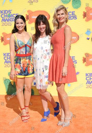Melissa Carcache, from left, Whitney Goin, and Mia Matthews arrive at Nickelodeon's 28th annual Kids' Choice Awards at The Forum, in Inglewood, Calif