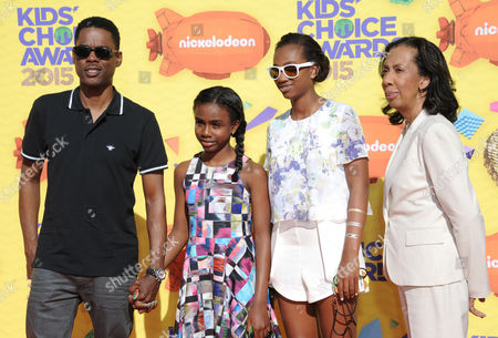 Chris Rock, and from left, Zahra Savannah Rock, Lola Simone Rock, and Rose Rock arrive at Nickelodeon's 28th annual Kids' Choice Awards at The Forum, in Inglewood, Calif