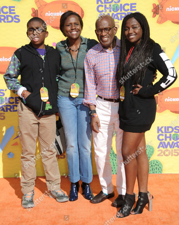 Al Roker, and from left, Nicholas Roker, Deborah Roberts, and Leila Roker, arrive at Nickelodeon's 28th annual Kids' Choice Awards at The Forum, in Inglewood, Calif