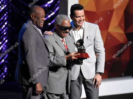 Johnny Ventura, from left, Lifetime Achievement award recipient Rafael Ithier and Victor Manuelle pose on stage at the Lifetime Achievement and Trustees Awards presentation at the Ka Theater in the MGM Grand Hotel, in Las Vegas