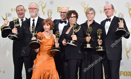 "David Chatsworth, from left, Gary Goetzman, Jane Anderson, Steven Shareshian, Lisa Cholodenko, Frances McDormand, and Richard Jenkins, winners of the award for outstanding limited series for ""Olive Kitteridge"", pose in the press room at the 67th Primetime Emmy Awards, at the Microsoft Theater in Los Angeles"