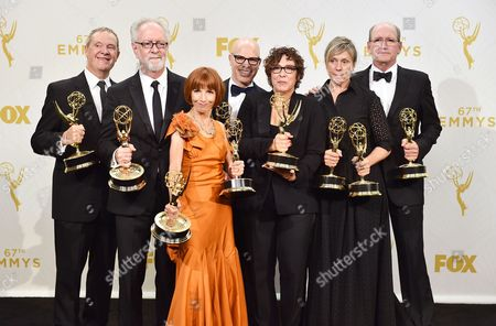 "Stock Picture of David Chatsworth, from left, Gary Goetzman, Jane Anderson, Steven Shareshian, Lisa Cholodenko, Frances McDormand, and Richard Jenkins, winners of the award for outstanding limited series for ""Olive Kitteridge"", pose in the press room at the 67th Primetime Emmy Awards, at the Microsoft Theater in Los Angeles"