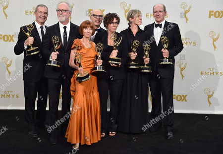 "Stock Image of David Chatsworth, from left, Gary Goetzman, Jane Anderson, Steven Shareshian, Lisa Cholodenko, Frances McDormand, and Richard Jenkins, winners of the award for outstanding limited series for ""Olive Kitteridge"", pose in the press room at the 67th Primetime Emmy Awards, at the Microsoft Theater in Los Angeles"