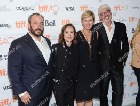 """Producers, from left, Aaron Gilbert, Elliot Page, Kelly Bush Novak and Niv Fichman attend the premiere for """"Into The Forest"""" on day 3 of the Toronto International Film Festival at the Winter Garden Theatre, in Toronto"""