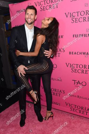 Stock Picture of Basketball player Jared Homan, left, and model Lais Ribeiro attend the 2015 Victoria's Secret Fashion Show After Party at Tao, in New York. The Victoria's Secret Fashion Show will air on CBS on Tuesday, December 8th at 10pm EST