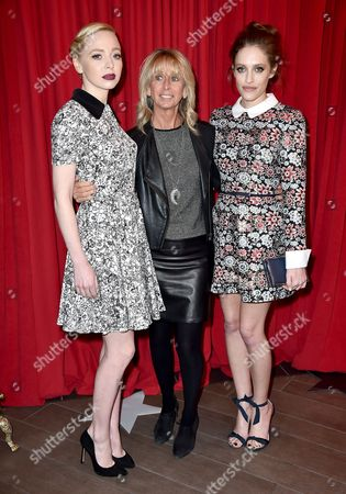 Stock Picture of Portia Doubleday, from left, Bonnie Hammer and Carly Chaikin arrive at the AFI Awards at the Four Seasons Hotel, in Los Angeles