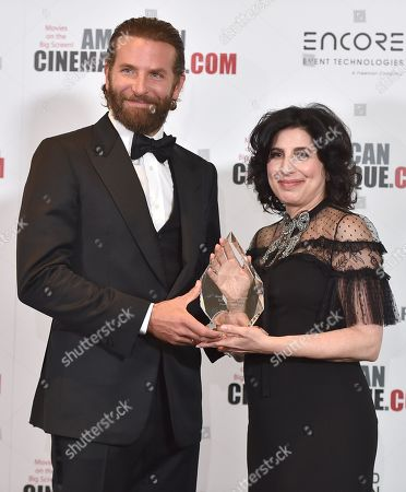 Bradley Cooper, left, and Sid Grauman award honoree Sue Kroll attend the 30th annual American Cinematheque Award Honoring Ridley Scott at the Beverly Hilton Hotel, in Beverly Hills, Calif
