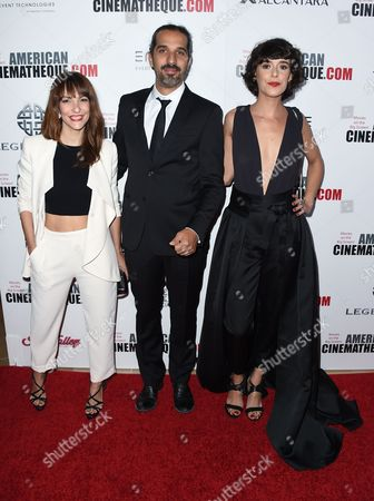 Paula Ortiz, from left, Javier Ruiz Caldera and Belen Cuesta arrive at the 30th annual American Cinematheque Award Honoring Ridley Scott at the Beverly Hilton Hotel, in Beverly Hills, Calif