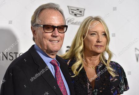 Peter Fonda, left, and Parky Fonda arrive at the amfAR Inspiration Gala Los Angeles at Milk Studios on