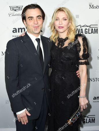 Courtney Love, right, and Nicholas Jarecki arrive at the amfAR Inspiration Gala Los Angeles at Milk Studios on