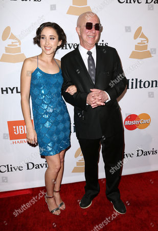 Victoria Lily Shaffer, left, and Paul Shaffer arrive at the 2016 Clive Davis Pre-Grammy Gala at the Beverly Hilton Hotel, in Beverly Hills, Calif