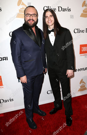 Desmond Child, left, and Anthony De La Torre arrive at the 2016 Clive Davis Pre-Grammy Gala at the Beverly Hilton Hotel, in Beverly Hills, Calif
