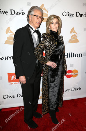 Richard Perry, left, and Jane Fonda arrive at the 2016 Clive Davis Pre-Grammy Gala at the Beverly Hilton Hotel, in Beverly Hills, Calif