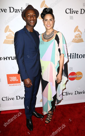 Aloe Blacc, left, and Maya Jupiter arrive at the 2016 Clive Davis Pre-Grammy Gala at the Beverly Hilton Hotel, in Beverly Hills, Calif