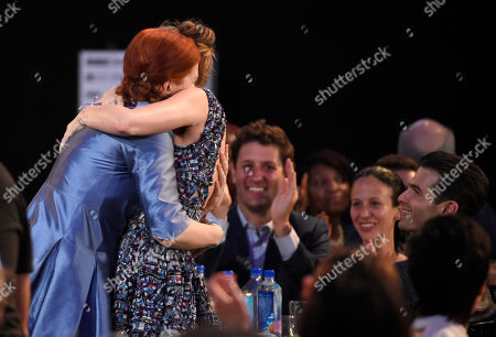 """Emma Donoghue, left, hugs Brie Larson in the audience after winning the award for best screenplay for """"Room"""" at the Film Independent Spirit Awards, in Santa Monica, Calif"""