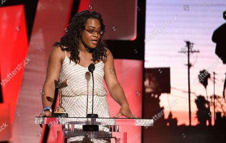 Mya Taylor accepts the award for best supporting female for Tangerine at the Film Independent Spirit Awards, in Santa Monica, Calif