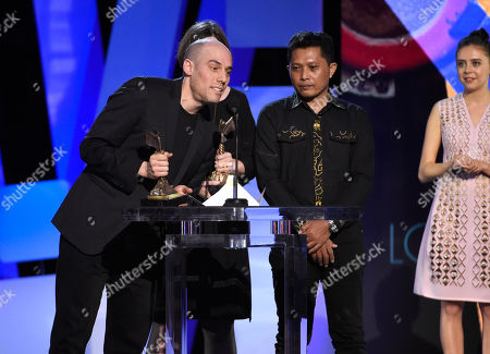 Joshua Oppenheimer, left, accepts the award for best documentary for The Look of Silence at the Film Independent Spirit Awards, in Santa Monica, Calif