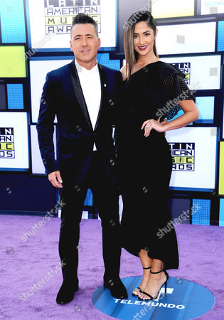 Jorge Bernal, left, and Karla Birbragher arrive at the Latin American Music Awards at the Dolby Theatre, in Los Angeles