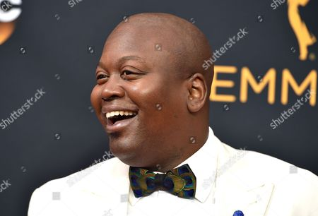 Titus Burgess arrives at the 68th Primetime Emmy Awards, at the Microsoft Theater in Los Angeles