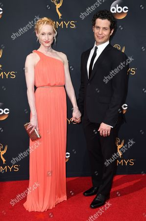 Angela Christian, left, and Thomas Kail arrive at the 68th Primetime Emmy Awards, at the Microsoft Theater in Los Angeles