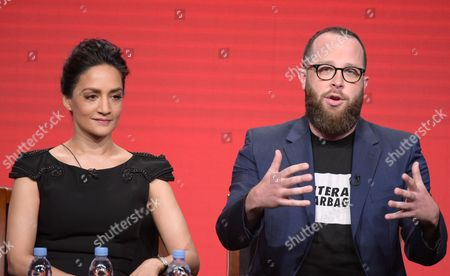 """Archie Panjabi, left, and executive producer Martin Gero participate in the """"Blindspot"""" panel during the NBCUniversal Television Critics Association summer press tour, in Beverly Hills, Calif"""