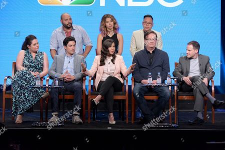 """Colton Dunn, from back row left, Nichole Bloom and Nico Santos, and from front row left, Lauren Ash, Ben Feldman, America Ferrera, Mark McKinney and executive producer Justin Spitzer participate in the """"Superstore"""" panel during the NBCUniversal Television Critics Association summer press tour, in Beverly Hills, Calif"""