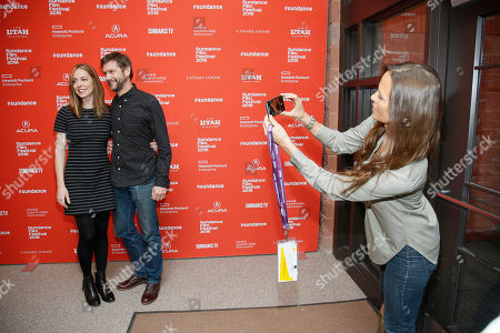 """Stock Image of Director and writer Sian Heder and husband and executive producer David Newsom pose while producer Heather Rae takes their photo at the premiere of """"Tallulah"""" during the 2016 Sundance Film Festival, in Park City, Utah"""