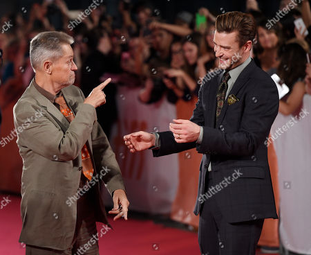 """Jonathan Demme, left, director of the concert film """"Justin Timberlake + The Tennessee Kids,"""" mingles with star Justin Timberlake at the premiere of the film on day 6 of the Toronto International Film Festival at Roy Thomson Hall, in Toronto"""