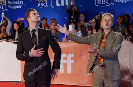 """Jonathan Demme, right, director of the concert film """"Justin Timberlake + The Tennessee Kids,"""" gestures to star Justin Timberlake on the red carpet at the premiere of the film on day 6 of the Toronto International Film Festival at Roy Thomson Hall, in Toronto"""