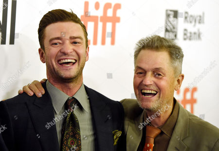 """Justin Timberlake, left, star of the concert film """"Justin Timberlake + The Tennessee Kids,"""" and director Jonathan Demme share a laugh at the premiere of the film on day 6 of the Toronto International Film Festival at Roy Thomson Hall, in Toronto"""